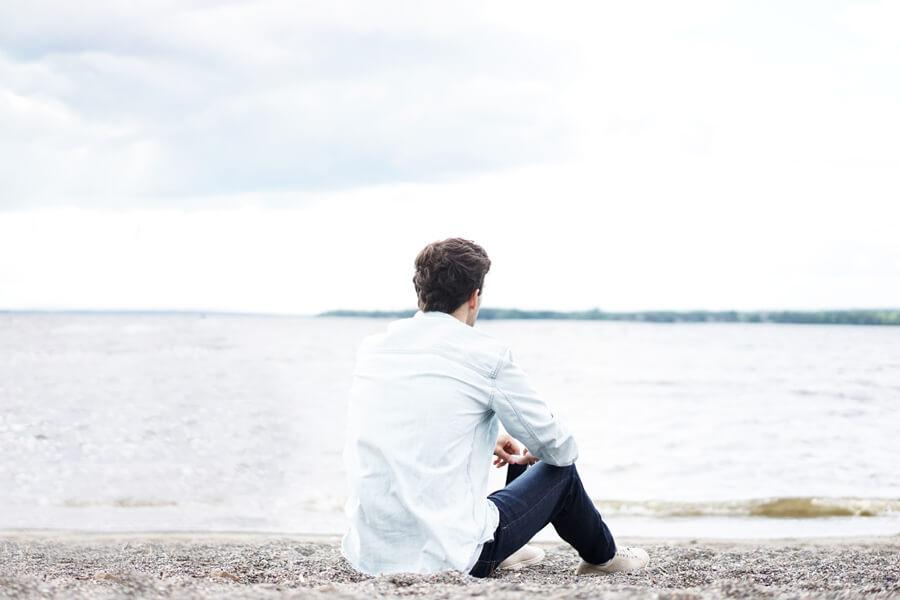 man sat on shore, depression, mental health