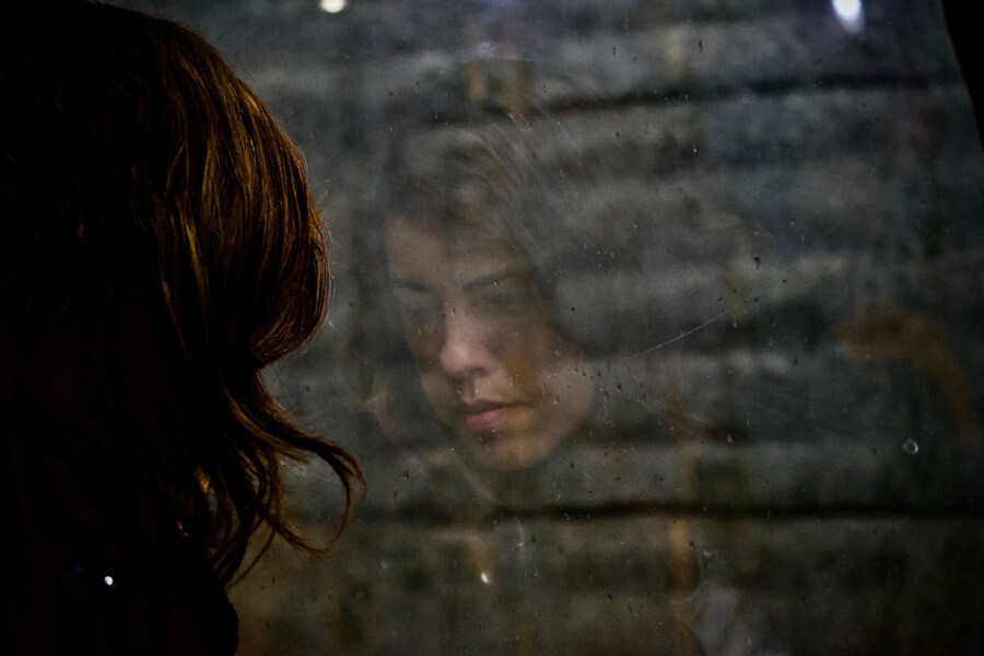 woman looking down, sad, depressed