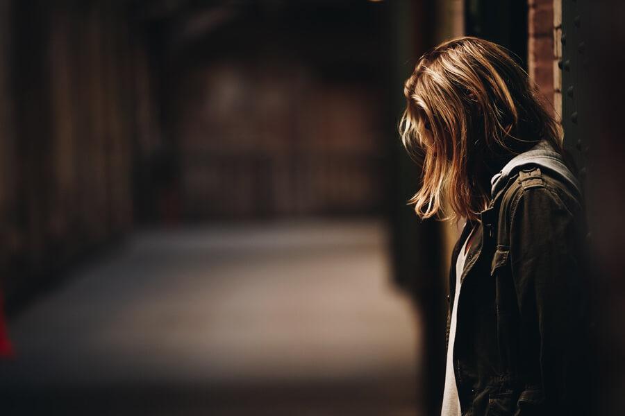 woman head down, depressed