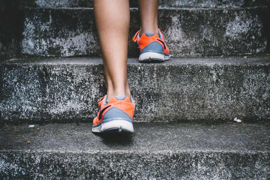 woman running up stairs, exercise