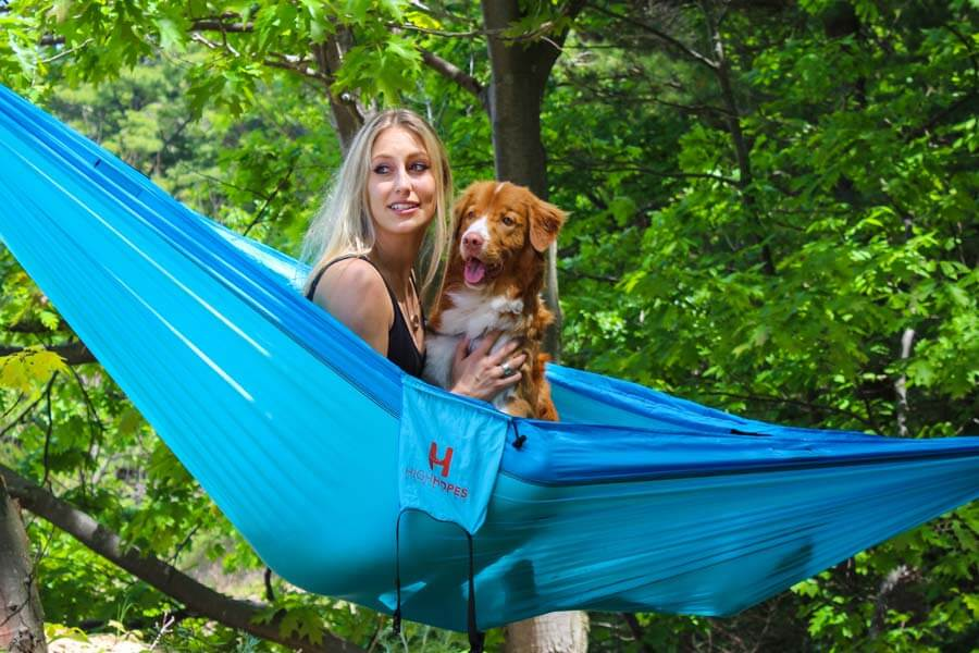 woman with dog in hammock