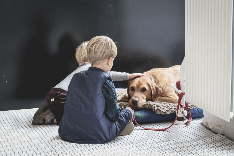kids and pet dog sitting on the floor