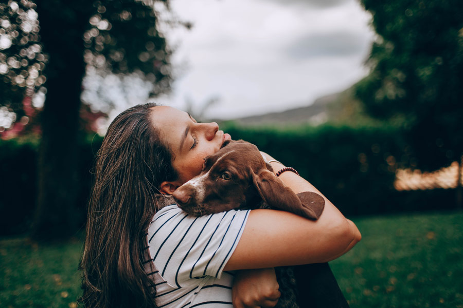 woman hugging dog, dealing with difficult clients
