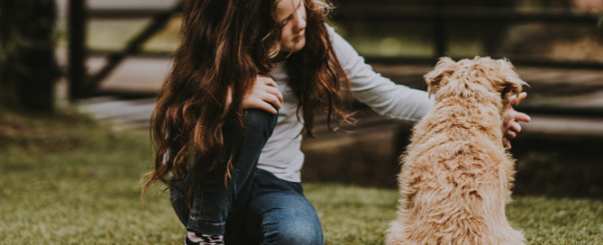 young girl petting dog outdoors, kids and pets