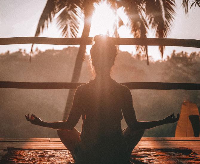 woman doing yoga, self care