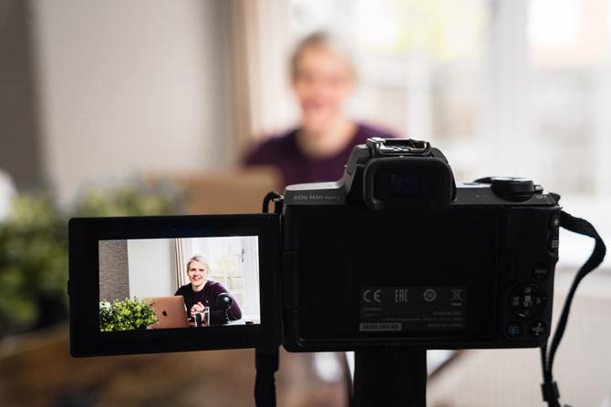 woman behind camera, pet professional
